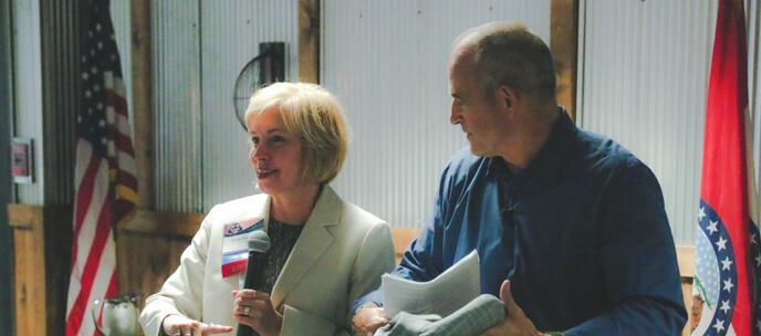 Ronda and Gary Pinkel presenting